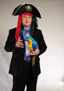 Jim Cooper doesn't always dress like a pirate, but when he does he carries a parrot